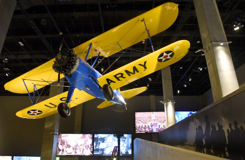 The blue and yellow open cockpit biplane, a PT-13 Kaydet built in 1944 and flown by the legendary Tuskegee Airmen during World War II is on display in the National Museum of African American History and Culture.  The museum, located on the National Mall, opens September 24. It has 34,000 artifacts housed in 400,000-square-foot structure.  Sixty percent of the building is below ground. (Kim Hairston/Baltimore Sun)